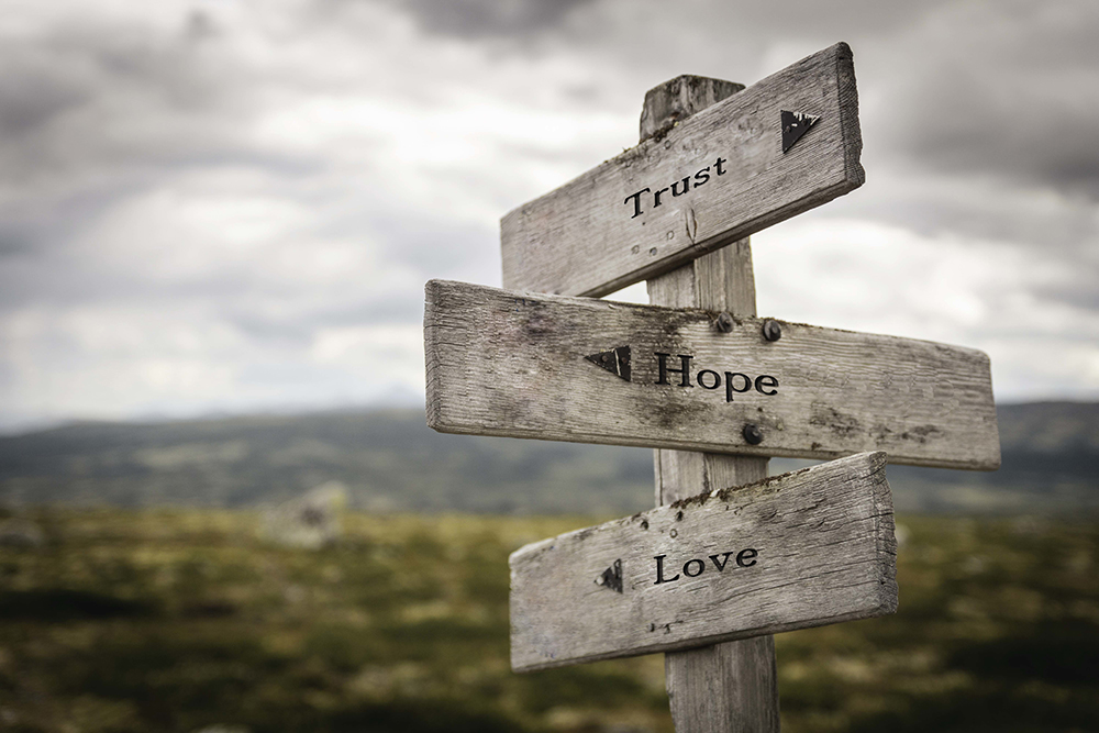 Wooden Road signs with Trust Hope Love